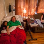 Cindy broke her pelvis earlier this year and currently sleeps in a hospital bed in the family's living room--where she was found enjoying some quality time with her daughters.