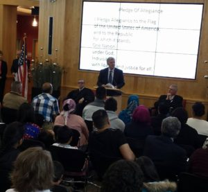Lincoln Mayor Chris Beutler spoke at a naturalization ceremony for 29 new American citizens.